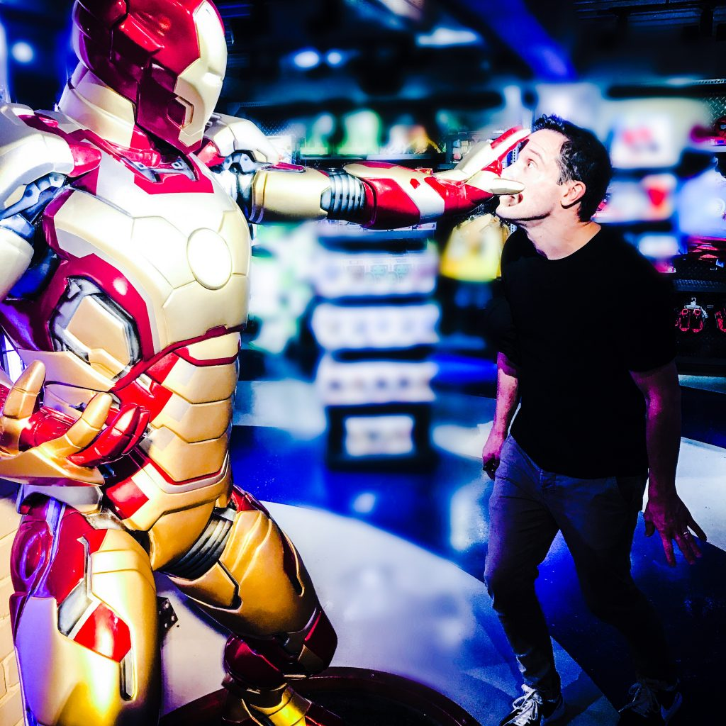 Image shows Declan Buckley interacting with a life-size robot from Disney's Transformers franchise. The robot's hand is outstretched and covering Declan's face.