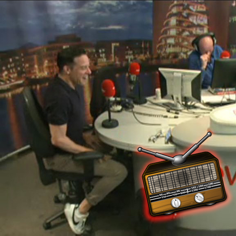 Image shows Declan in the Newstalk radio studio with Sean Moncreiff. Sean is laughing at something that Declan has just said.